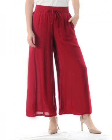 TINA SOLID FLARED LONG PANTS IN MAROON